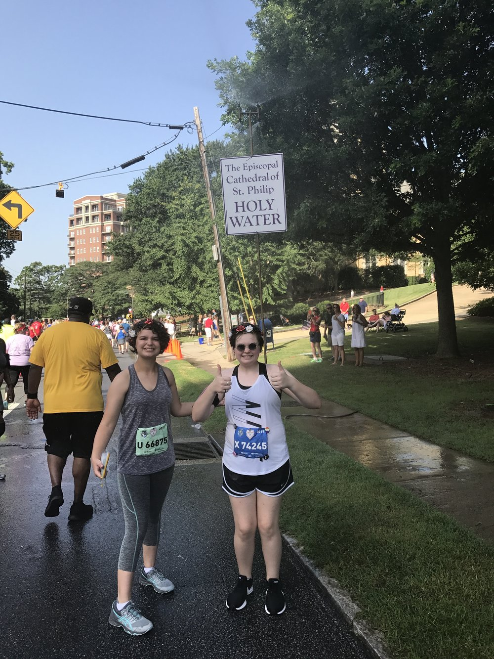 "Gracie and CJ ""running"" the Peachtree Road Race on 7/4/17"