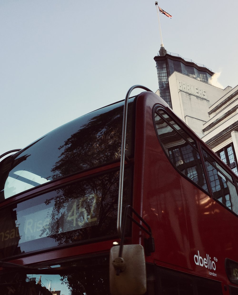 red London bus with the Barkers building in background.jpg