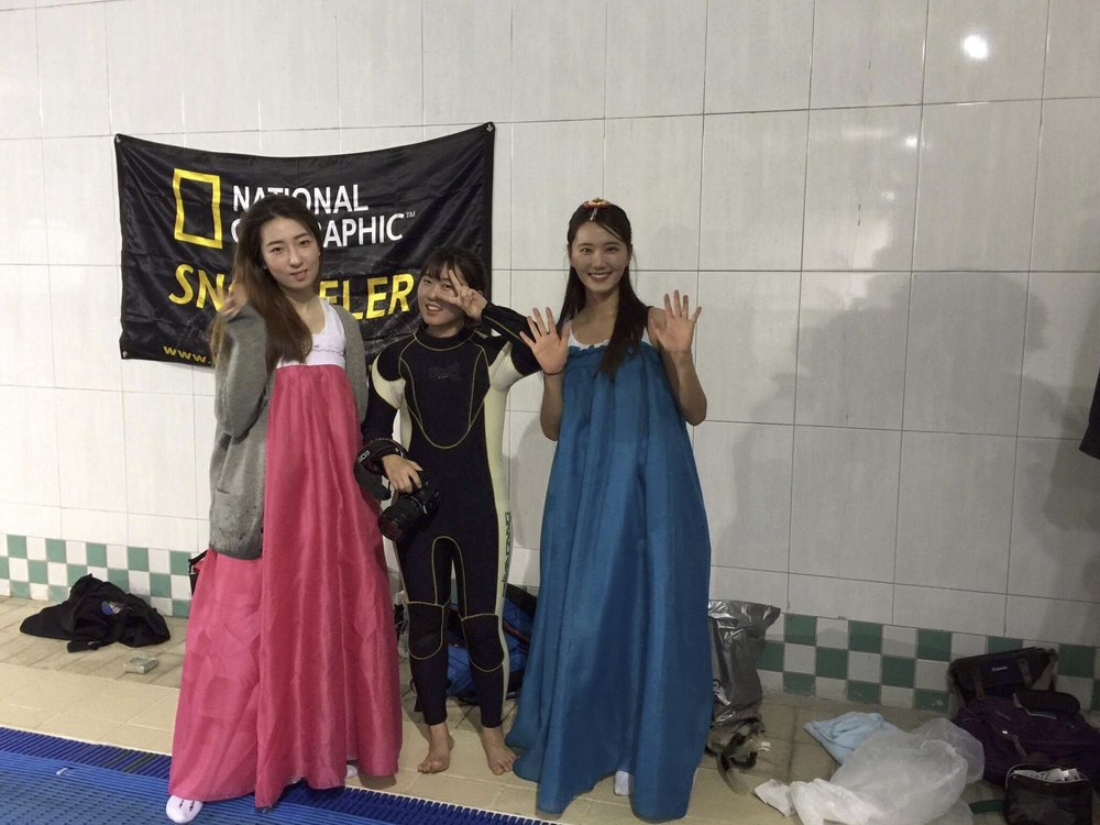 Students model Korean dress with Yzin in middle