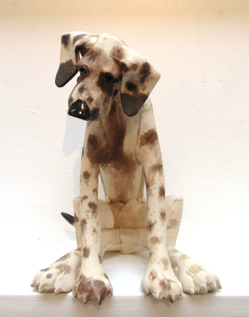 Large Spotted Sitting Dog