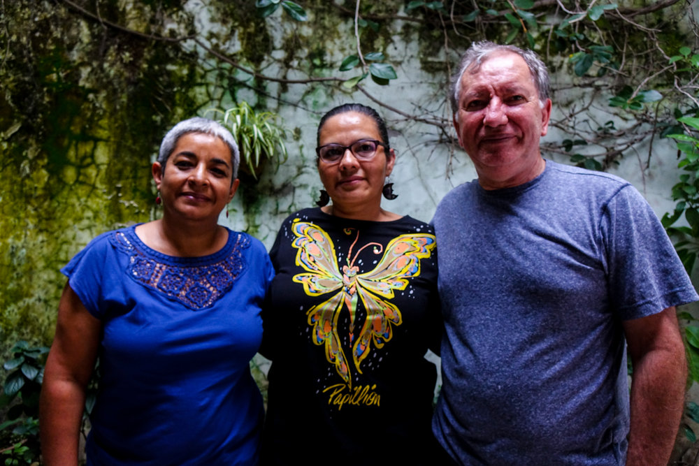 Merly (left), Cristina (middle), and Horizons staff member Sergio (right) pose for a picture after a productive meeting in Tegucigalpa.