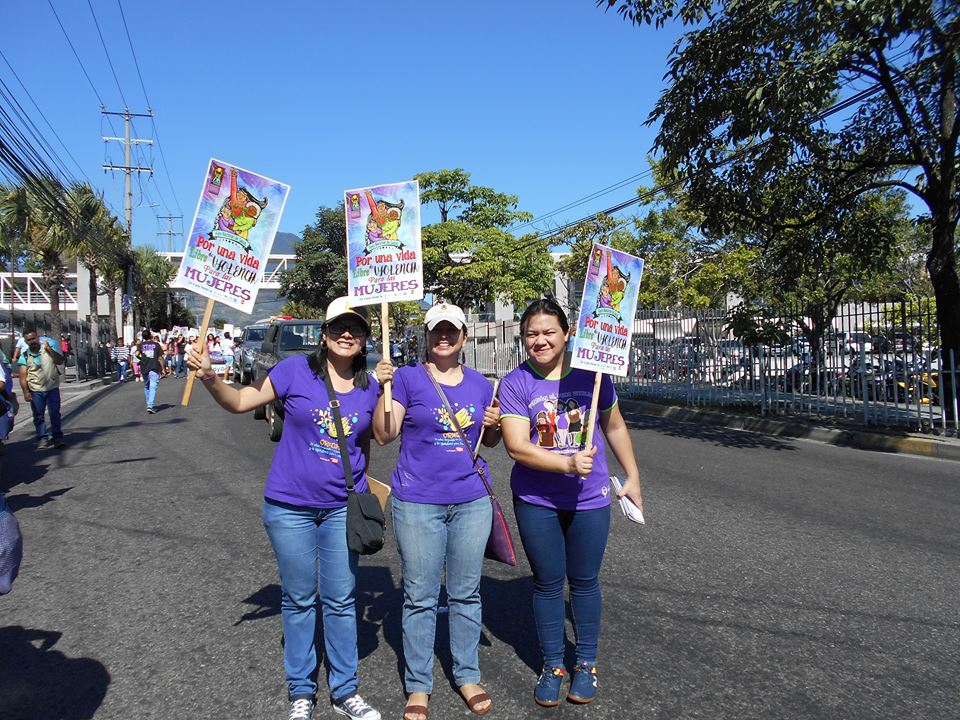 Members of ORMUSA march to raise awareness on violence against women in El Salvador.