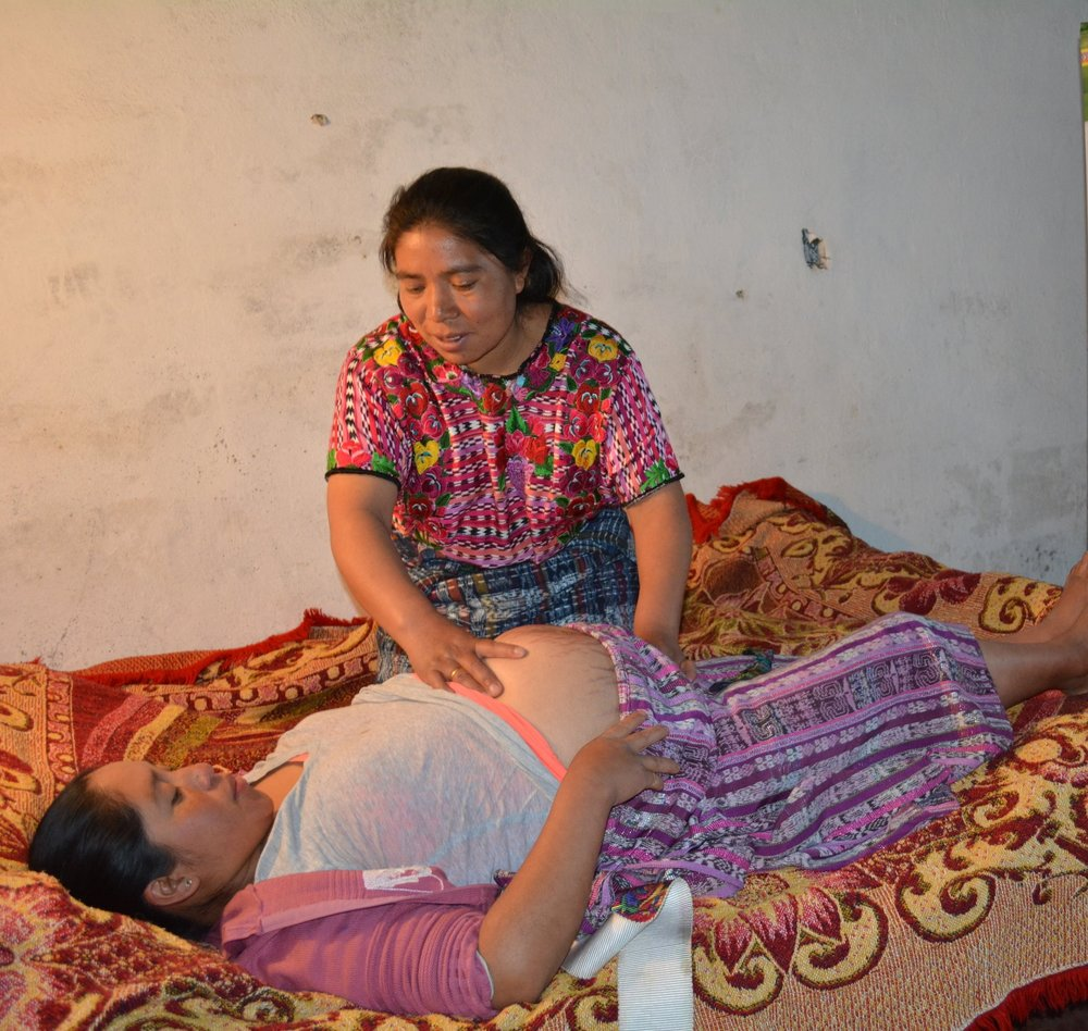 An Indigenous traditional midwife checks up on her pregnant patient in a rural community of Totonicapán, Guatemala. Midwives are currently the most accessible and acceptable maternal health service for most Indigenous families in Guatemala.
