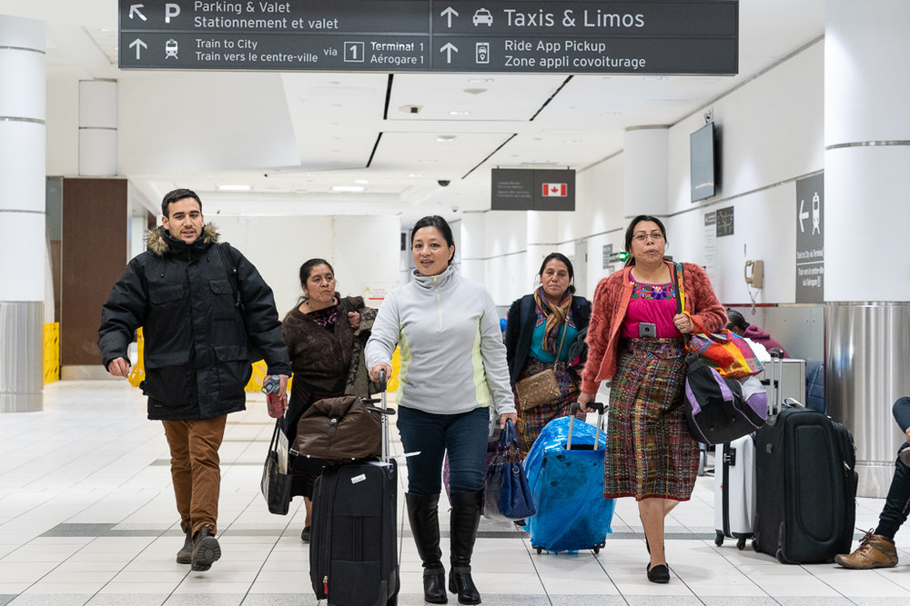 Left to right: Horizons Community Outreach/Communications Coordinator Raúl Scorza; traditional Indigenous Maya K'iche' midwife Irma Ixcayau; DAST Head Nurse María del Rosario Orozco; traditional Indigenous Maya K'iche' midwife Margarita Aguilar Puac; and PIES health educator/Indigenous leader Mirna Pretzantzin arriving at Pearson International Airport.