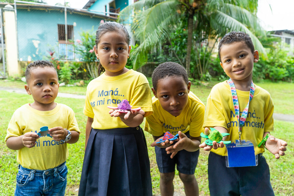Youth at the Madres Maestras youth community centre showing off their latest arts and crafts in San Miguelito, Panama.