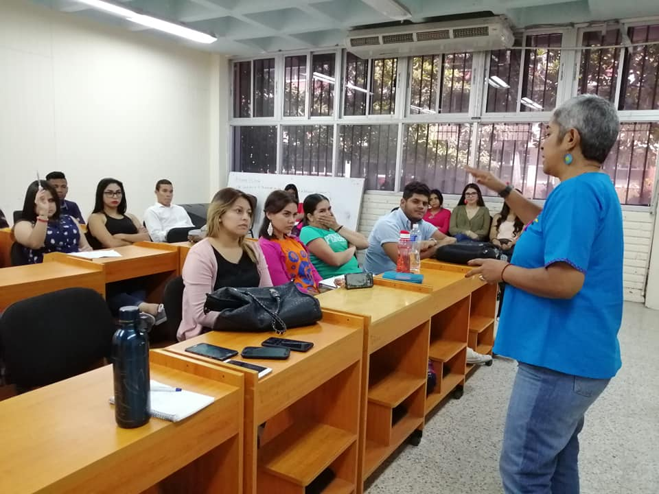 Merly Eguigure, from Visitacion Padilla, lecturing students and young professionals on violence against women and femicide in Honduras.
