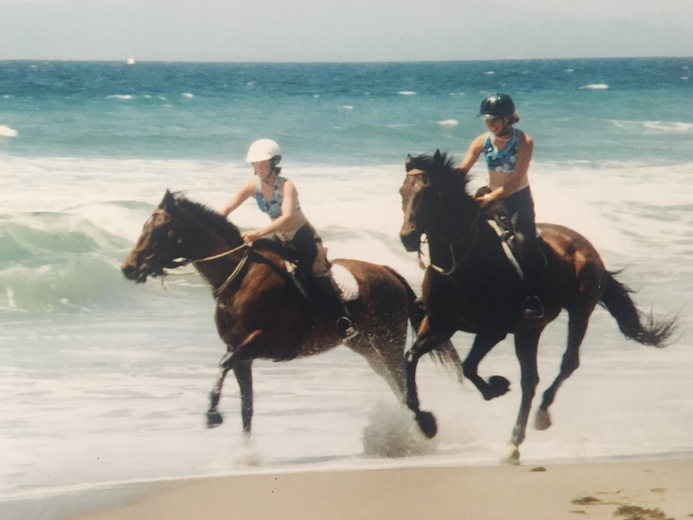Freedom on the beach: Two girls and their horses, circa 2000; Kacey on Athena (left), Lauren on Baron (right)