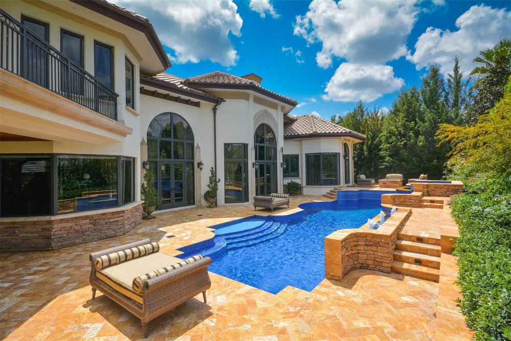 custom-backyard-beautiful-pool-tanning-entertaining.jpeg