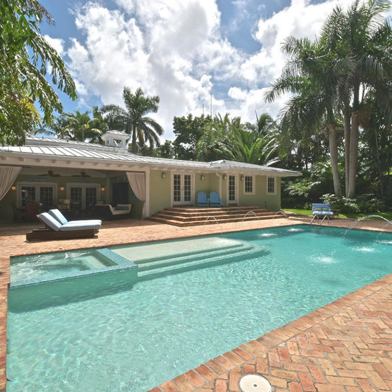 backyard_water_feature_luxury_pool_brick_loggia_tanning_florida_architecture.jpg