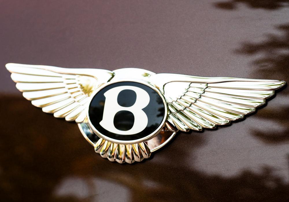 Bentley-logo-on-maroon-car.jpg
