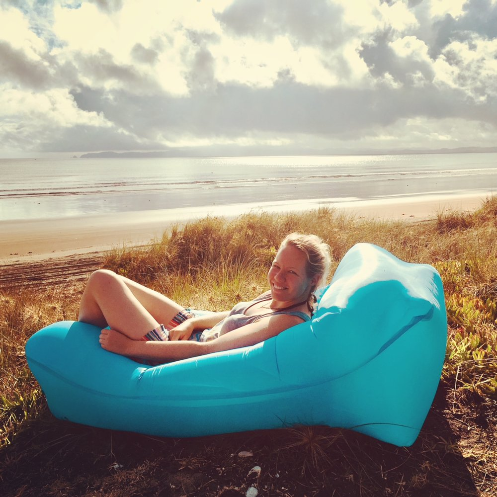 Relaxing in my new inflatable lounger at Tokerau Beach