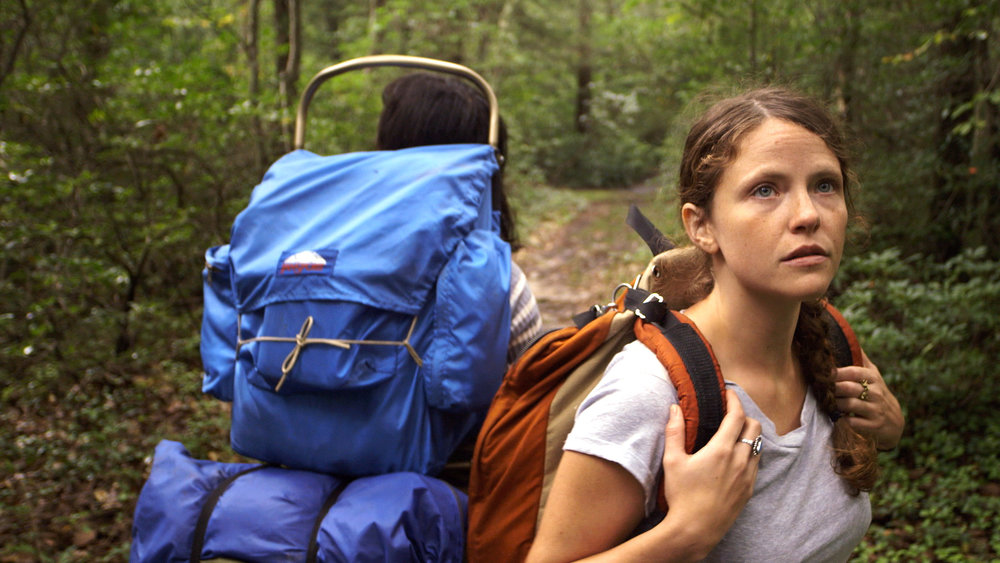 In The Hollow - In May 1988, girlfriends Claudia Brenner and Rebecca Wight were attacked while hiking the Appalachian Trail by a 'mountain man' named Stephen Roy Carr. Combining documentary and narrative material, IN THE HOLLOW tells the story of the shooting, Wight's death, and Brenner's desperate survival (and later transformation into an advocate for hate crime legislation in the U.S.) as she returns to the trail for the first time since the shooting.
