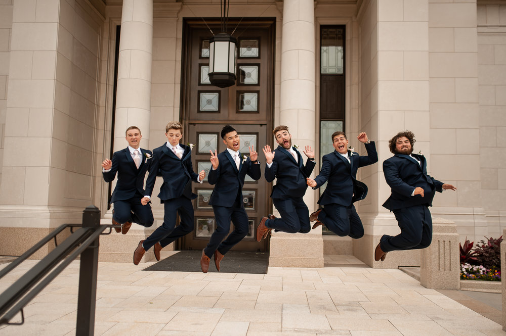 Groom & groomsmen having some fun mid-air.
