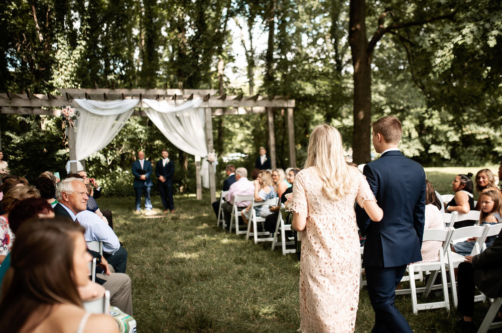 Bridal party walking down the aisle in the beautiful weather.