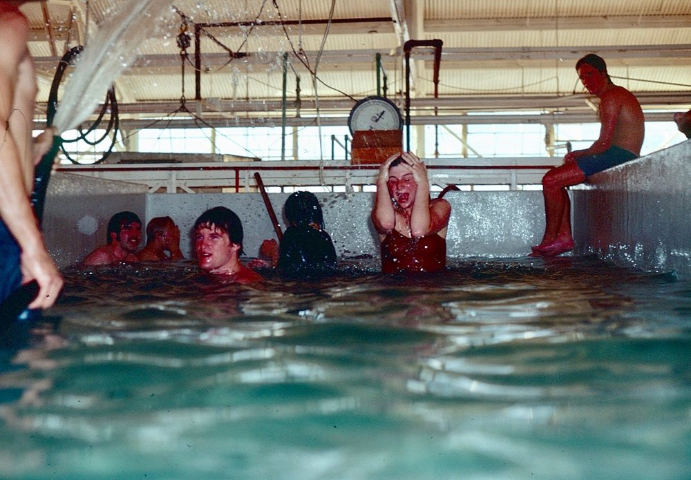 Cannery workers break for a swim in one of the fish holds of the NN Cannery in the summer of 1976.