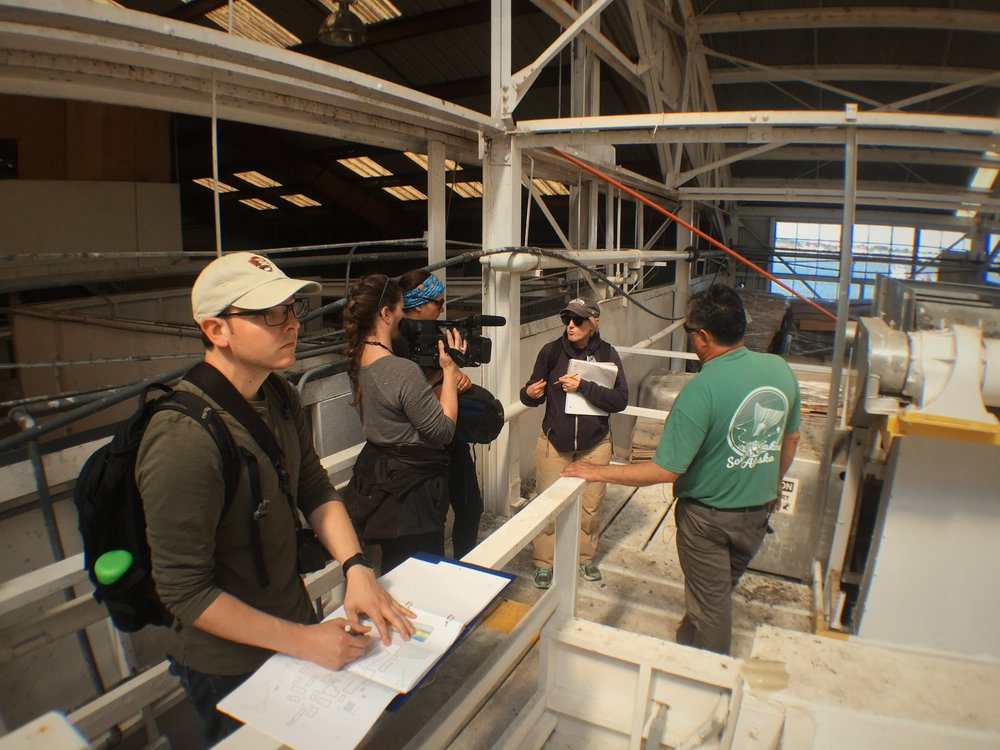 The NN Cannery Project Team on location in the Fish House documenting research to support the Nomination.