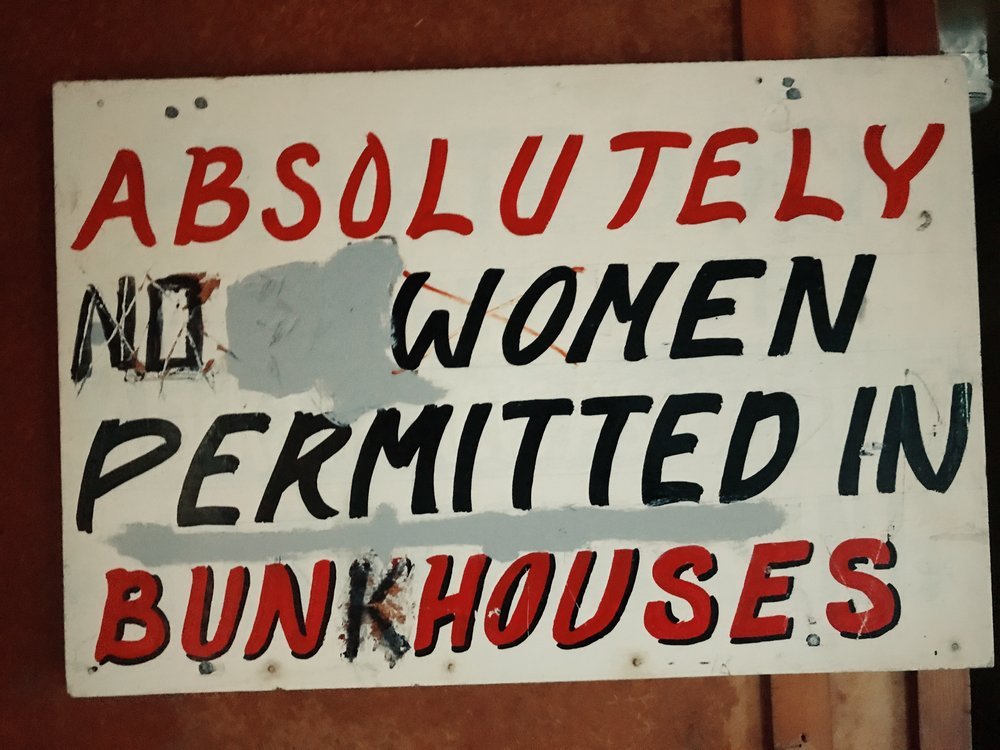 This sign is mounted just inside the Fisherman's Bunkhouse and demonstrates the arrival of women in the cannery workforce and the dynamic evolution of attitudes towards them.