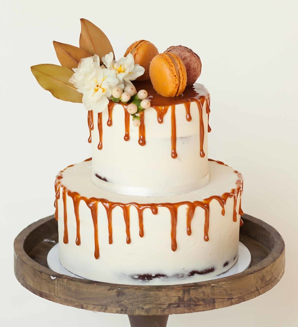 semi naked cake with drip & flowers.jpg