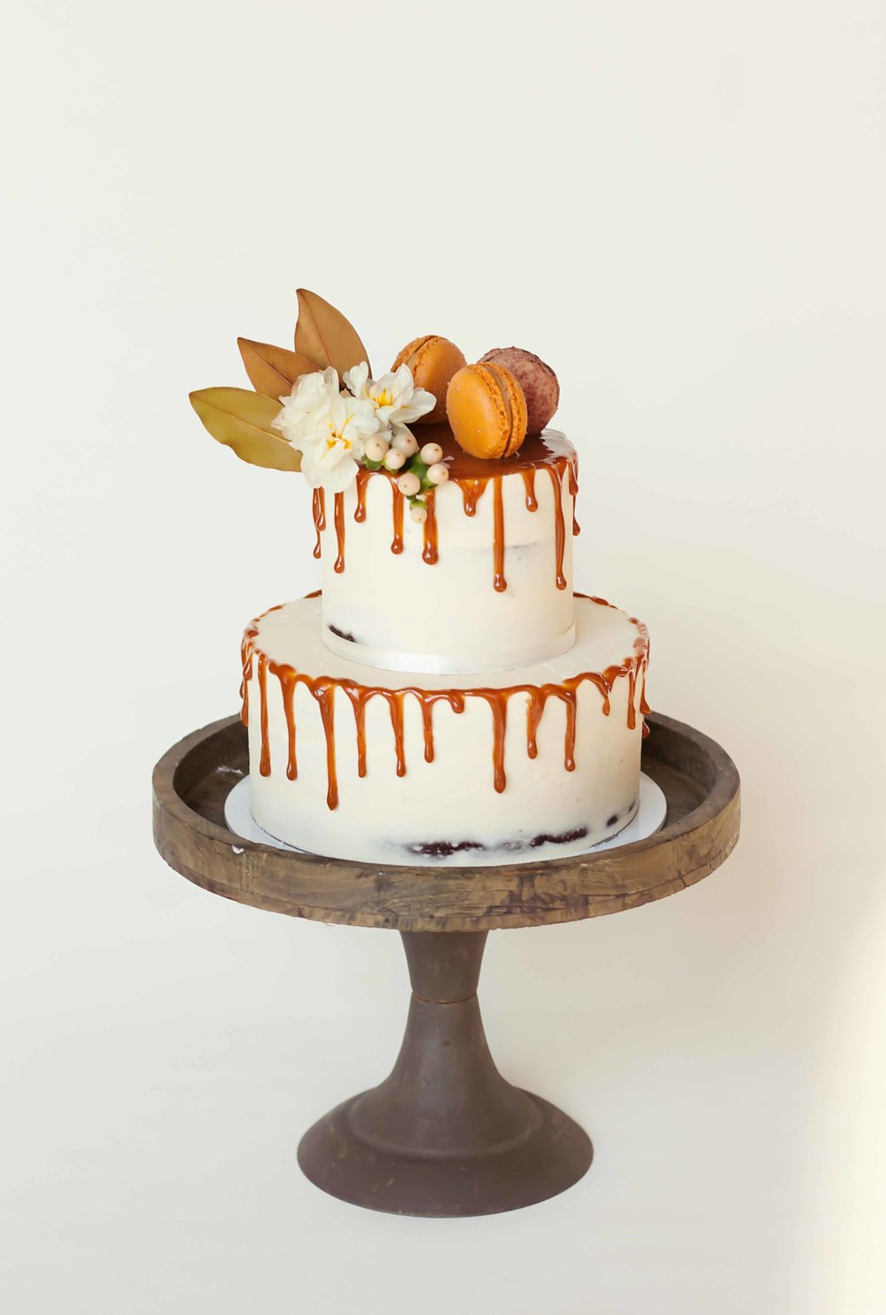 semi naked cake with drip & flowers.jpg