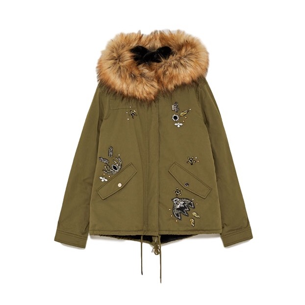 Zara - Sequinned Parka With PatchesBundle up against the bitter cold by layering on a khaki parka coat. Choosing one with contrasting embroidered bead patches and shimmery details for an hourglass-accentuating (and stylish!) effect.