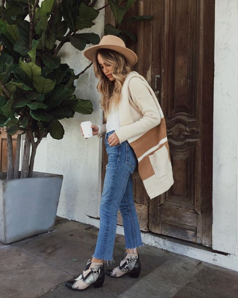 """- Whether your exploring caves or just curling up on the couch, this tan and beige cardigan sweater is the perfect choice - cozy knit in a beautiful beige, ivory, and tan striped pattern!@claudiagrazianois 5'1"""" and 100 lbsTop: Free PeopleCardigan: Lulu's Small/MediumJeans: GRLFRND DenimBooties: Matisse Footwear US6Hat: WYETH"""