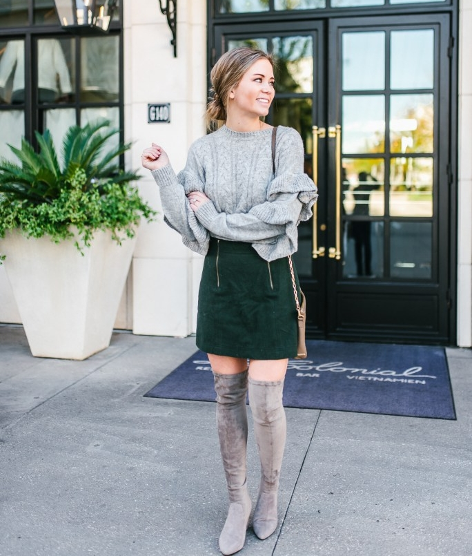 """- Classic cable knitting paired with pretty ruffles gives this sweater a stylish update for the winter season. Add more feminine touches by pairing it with a pair of taupe over the knee suede boots and a wool-blend mini skirt@littlebitoflivingis 5'3"""" and 115 lbsSweater: WAYF XsmallSkirt: Madewell Size 0Boots: Goodnight Macaroon US7.5"""