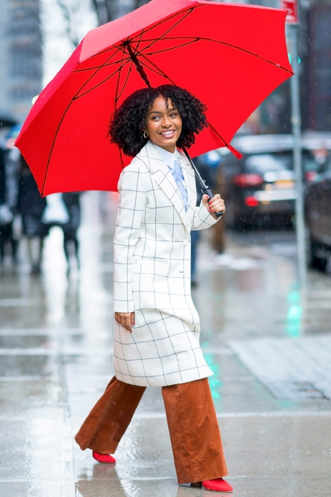 A bold look in a checked coat and red booties that truly brightens up a dreary day.