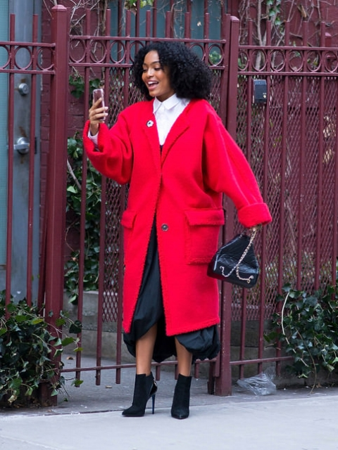 A major street style inspo in a menswear-inspired red coat.