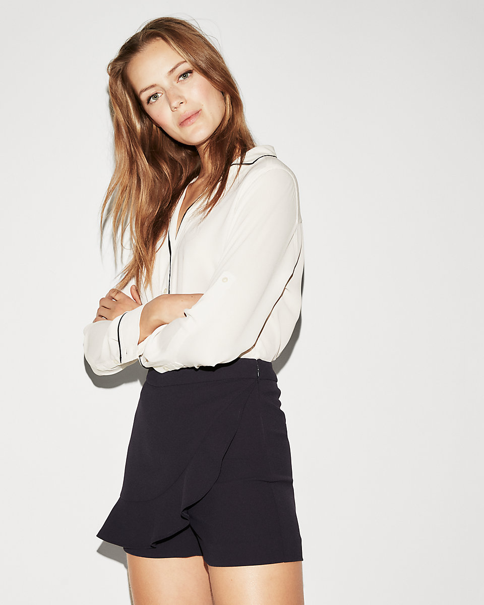 Express - Asymmetrical Ruffle Front SkortA smooth, sharp asymmetrical skirt look with the confidence of shorts underneath.