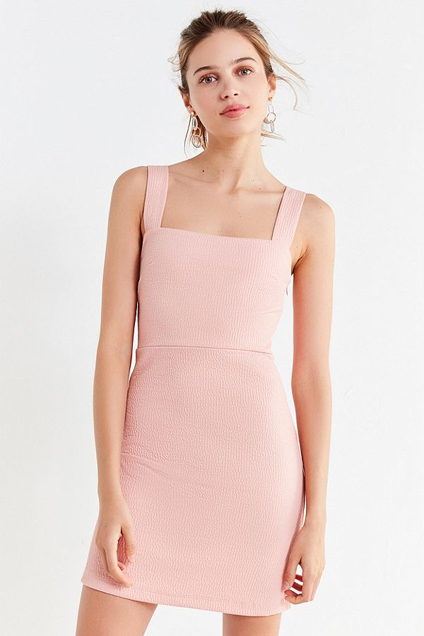 Urban Outfitters - Britt Textured Square-Neck Mini DressSimply chic in this textured square-neck mini dress from Urban Outfitters. With a defined waist construction in a bodycon fit.