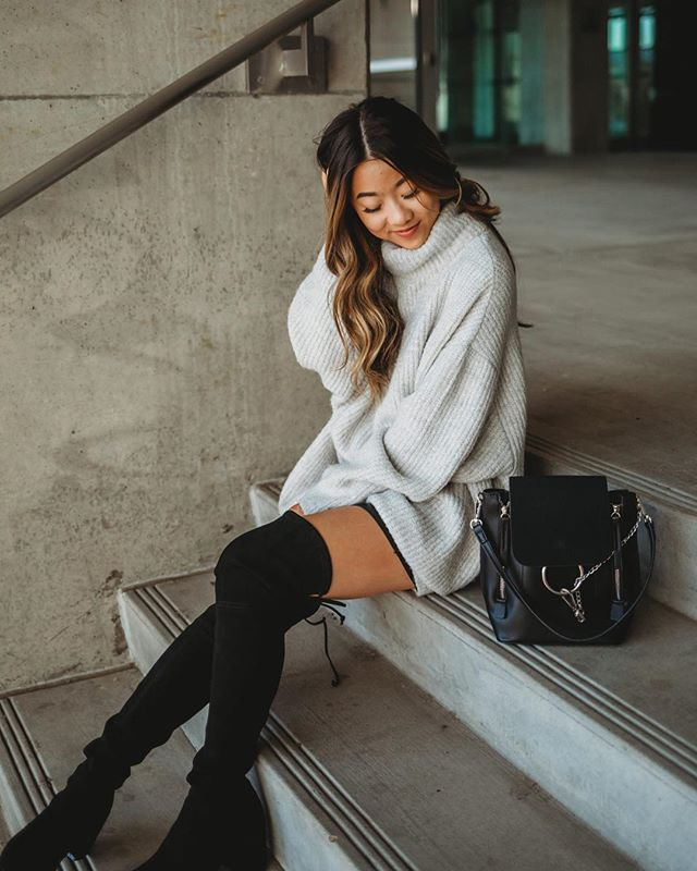 "Our go to 'fall chic' outfit is layering a chunky sweater over a skirt to give the illusion of a sweater dress! Finish the look with a pair of over the knee boots to stay warm and comfy. @itsmarisa_kay is 4'11"" and 98 lbs Sweater: Zara  XS Skirt: H&M  XS Boots: Stuart Weitzman  US6.5"