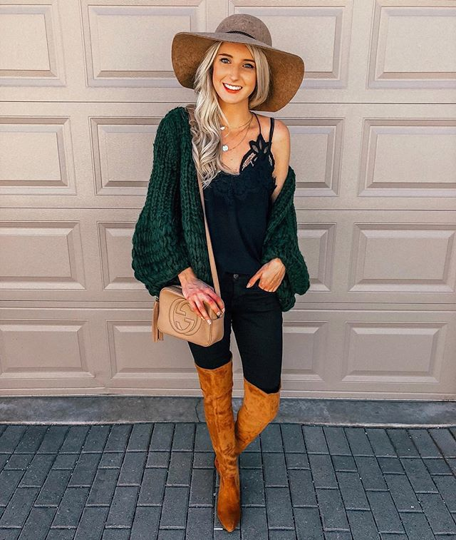"Play with proportions when you have an oversized knit cardigan. Style it with some knee-high boots to make it comfy yet chic. @pradaandpearls is 5'5"" and 115 lbs Cardigan: Goodnight Macaroon  One Size Cami: Abercrombie & Fitch  XS Boots: Goodnight Macaroon Hat: Halogen Bag: Gucci"