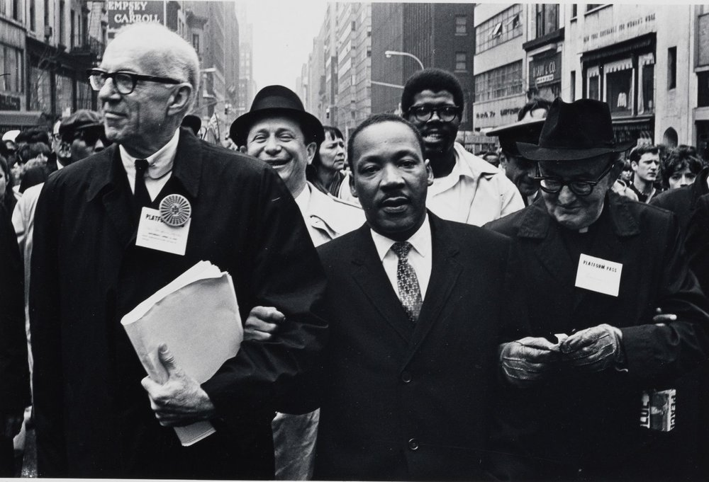 Dr. Benjamin Spock, Dr. King and Monsignor Rice of Pittsburgh march in the Solidarity Day Parade at the United Nations building (April 15, 1967);Photo by Benedict J. Fernadez, courtesy of MCNY