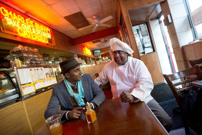 Marcus Samuelsson (left) with Charles Gabriel, the owner of Charles' Country Pan Fried Chicken, in Harlem.  Photograph by Joshua Bright/The New York Times/Redux