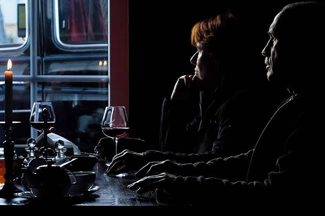A couple is sitting over red wine in a small pub located in Wisla, a mountainous city in southern Poland near the border with Czech Republic.  Wisla, Poland 2016 © Arek Rataj  #poland #couple #colorphotography #candid #unstaged #streetphotos #fujifilm #xpro2