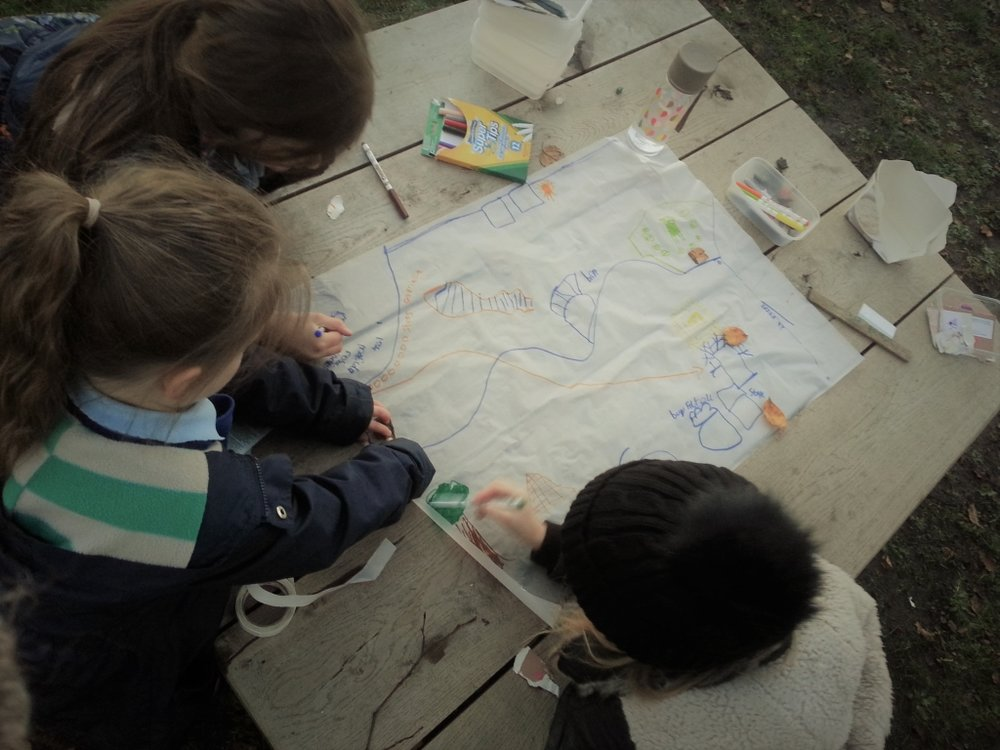 children mapping the garden.jpg