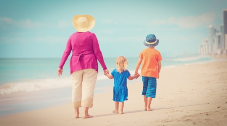 stock-photo-happy-grandmother-with-kids-walking-on-beach-668735827.jpg