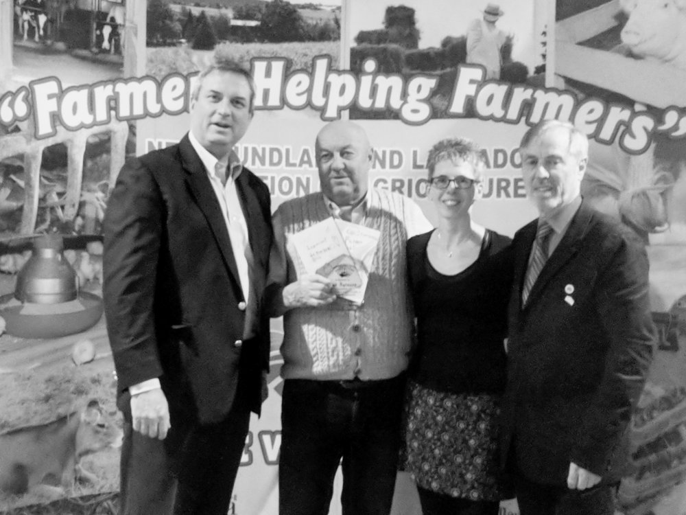 Bob Aylward received the NLFA's lifetime achievement award. From left, Fisheries and Land Resources Minister Gerry Byrne, Aylward, Nancy Ryan (a teacher at the school where Aylward mentors), and NLFA president Merv Wiseman. (Submitted photo)