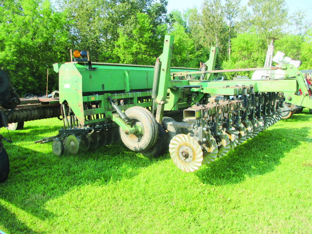Miller Farms' no-till grain drill has coulters that place the grain seed in narrow strips of soil.