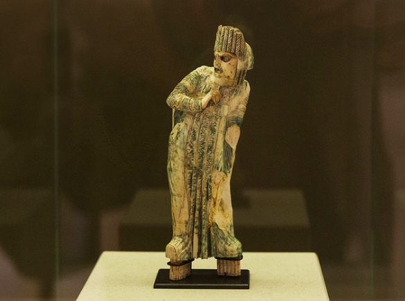 Figurine of an ancient actor, probably in a female role.