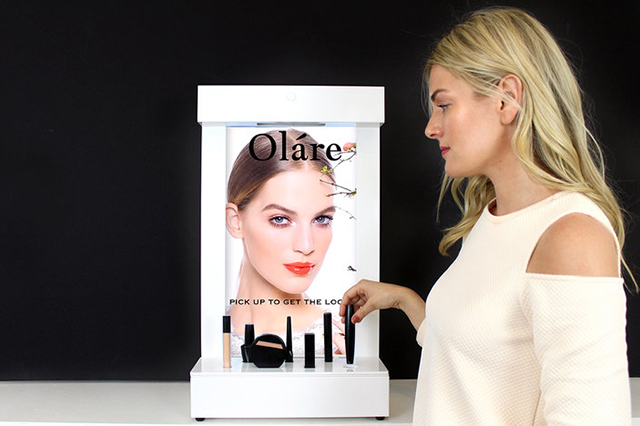 Cosmetics - Small format cosmetics marketing display for counter promotion and portability