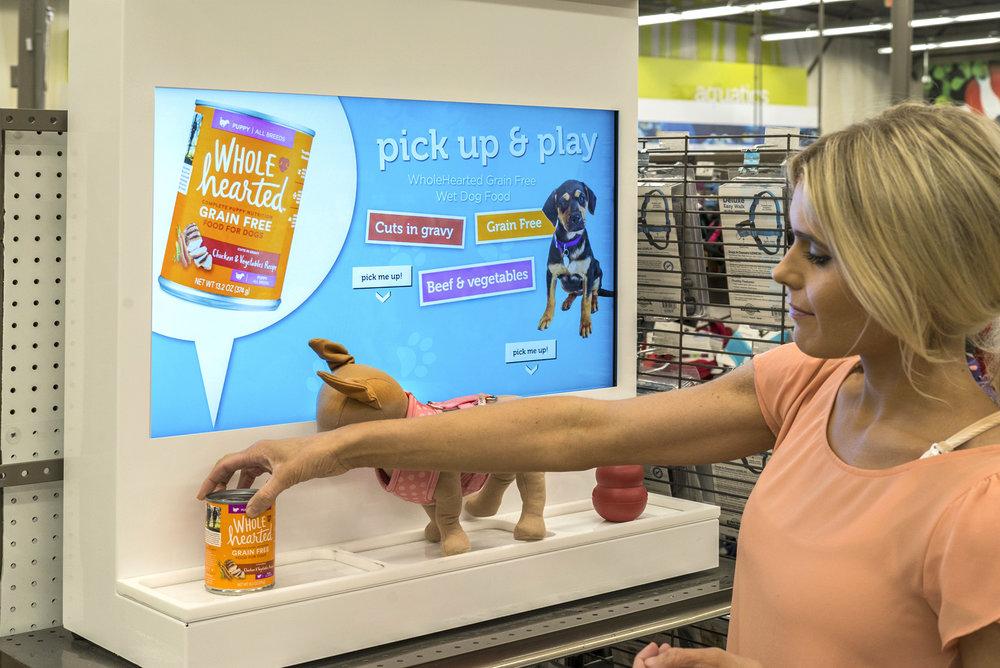Petco - Interactive shelf featuring pet accessories
