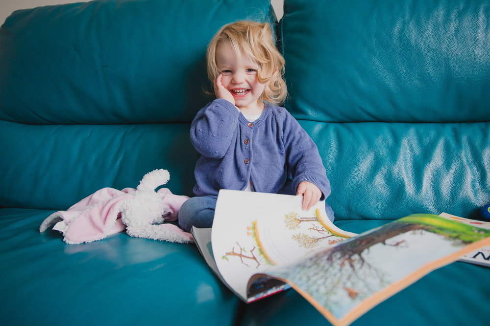 Toddler girl reading a story to her bunny on a rainy afternoon, Kirsty Hamilton Photography