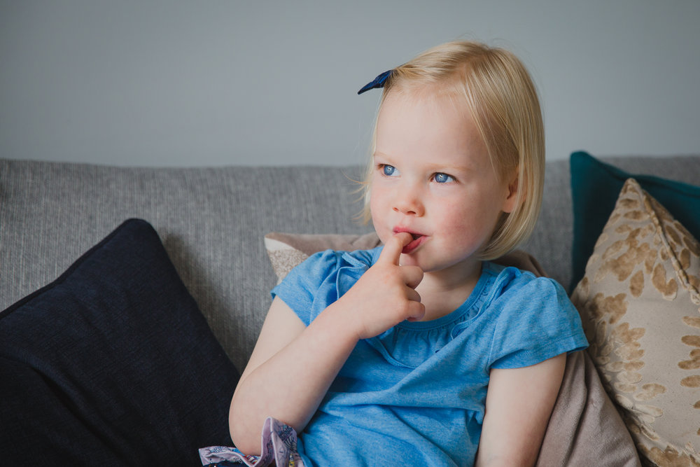 Toddler girl on sofa | Kirsty Hamilton Photography