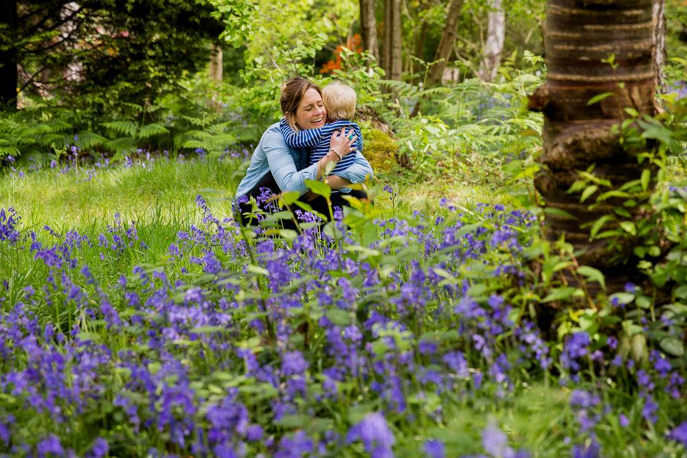 Mum hugging toddler in bluebells, Wimbledon Family Photographer