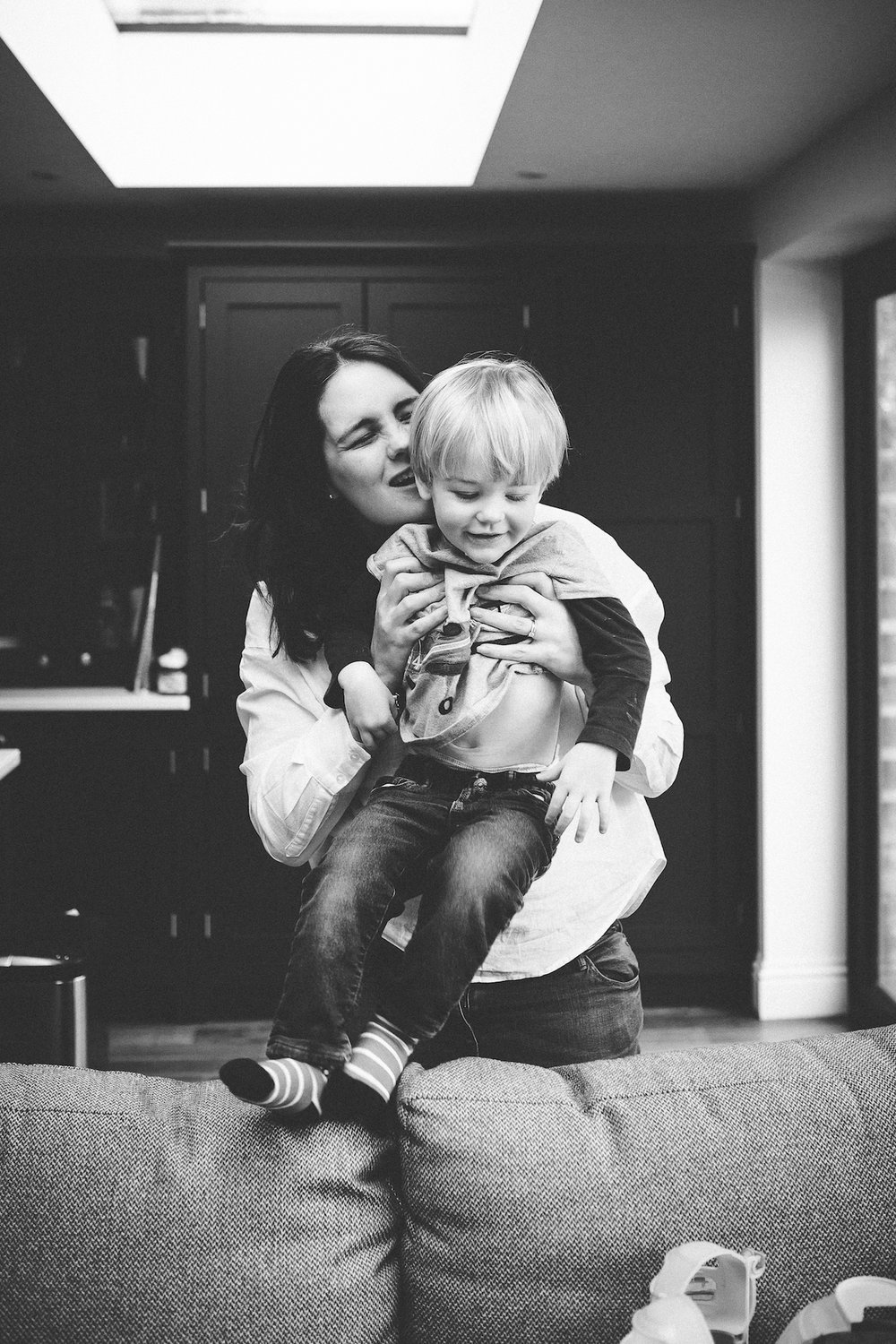 Mum tickles toddler, Earlsfield Family Photographer