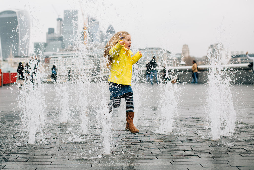 Girl in water fountains at Tower Bridge London, Family Photography Session