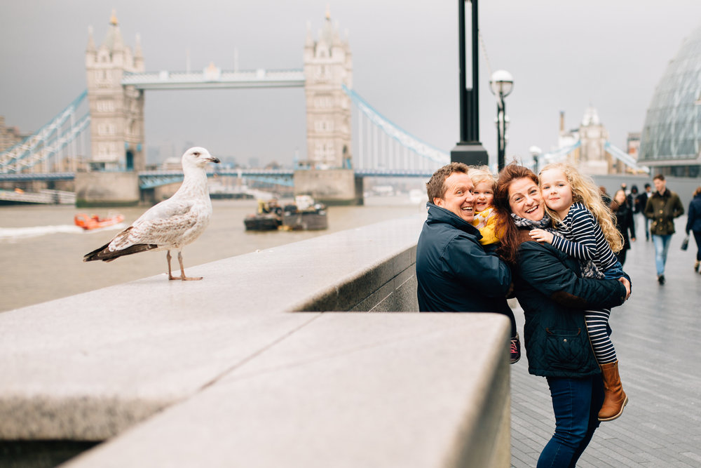 Family and seagull in front of Tower Bridge