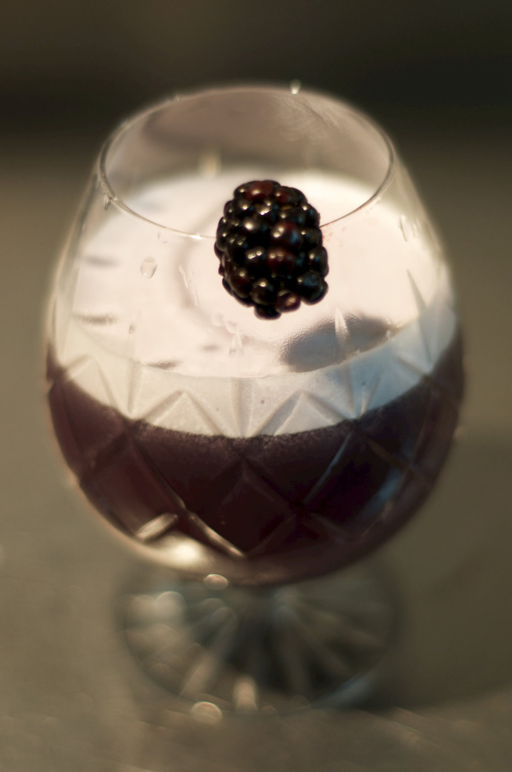 Lucyfer - Muddle half a handful of blackberries and the tip of a red chili.Add 30ml of vanilla-infused bourbon*, 15ml Chambord, 15ml Blue Curaçao, 25ml apple juice and 20ml egg white.Shake over ice and pour. Garnish with a blackberry.*A bottle of bourbon infused with one vanilla pod