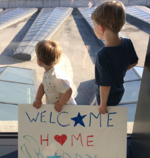 Two military children anxiously await their daddy's return from a deployment to the Middle East.